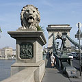 "The north western stone lion sculpture of the Széchenyi Chain Bridge (""Lánchíd"") on the Buda side of the river - Budapešť, Maďarsko"