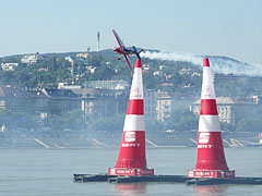 The German pilot Matthias Dolderer's high-performance aerobatic plane between the air pylons over the Danube River, in the Red Bull Air Race 2009, Budapest - Budapest, Ungarn