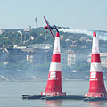 The German pilot Matthias Dolderer's high-performance aerobatic plane between the air pylons over the Danube River, in the Red Bull Air Race 2009, Budapest - Boedapest, Hongarije