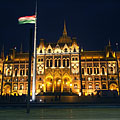 "The illuminated Country Flag and the Hungarian Parliament Building (in Hungarian ""Országház"") - Boedapest, Hongarije"