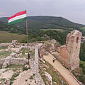 The view from above to the ruins of the Lower Castle, to the castle gate and the Clock Tower - Csesznek, Hongarije