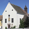 The baroque Capuchin Church, some distance away its wooden shingled small tower can be seen as well - Tata, Hongarije