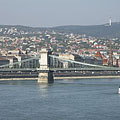 """The Buda-side of the Széchenyi Chain Bridge (""""Lánchíd""""), as well as there are houses on the Buda Hills and a TV-tower on the Hármashatár Hill in the background - Budapest, Ungari"""