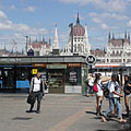 """Metro station in Batthyány Suare (""""Batthyány tér"""") with the Hungarian Parliament Building in the background - Budapest, Ungari"""