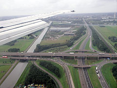 The wing flaps of the airplane are already released when approaching Amsterdam - Amsterdam, Netherlands