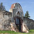The stone wall of the fortified church with a gate - Balatonalmádi, Hungary