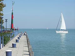 Beautiful white sailing boat heading towards the harbor - Balatonfüred, Hungary
