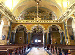 View to the main entrance: row of pews and the church organ on the choir loft - Budapest, Hungary