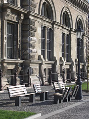 Benches and a lamp post in front of the main building of the Corvinus University of Budapest, on the riverbank side of the building - Budapest, Hungary