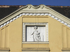 Relief on a yellow building - Budapest, Hungary
