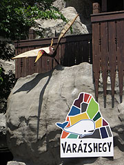 The entrance of the Magical Hill with a plastic ancient flying reptile - Budapest, Hungary