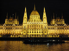 "The Hungarian Parliament Building (""Országház"") and the Danube River by night - Budapest, Hungary"