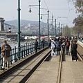 Promenading and picnic atmosphere on the tram rails, right beside the Duna Korzó promenade - Budapest, Hungary