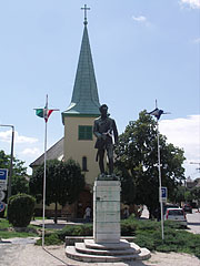 Statue of Sándor Petőfi Hungarian poet and liberal revolutionist in front of the Lutheran (evangelical) Church - Gödöllő, Hungary