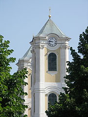 The towers of the St. Bartholomew's Church, from here seems to be in the linden trees of the main square - Gyöngyös, Hungary