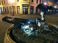 """Boy in a boat"" (or ""Nostalgia for the bygone era"") bronze statue on the pedestrian street at night - Győr, Hungary"