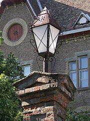 A street light on the flood protection wall at the gateway, in front of the Reformed high school - Hódmezővásárhely, Hungary