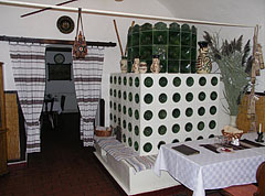 "A masonry heater (ceramic tile stove) in the Great Csarda (Inn) of Hortobágy, and some so-called ""Miska jugs"" (in Hungarian ""miskakancsó"") on it - Hortobágy, Hungary"