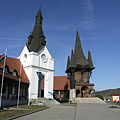 "Village Community Center (""Faluház""), the two different style building sections and towers, Swabian and Székely one - Kakasd, Hungary"