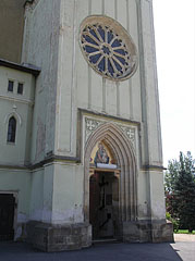 The entrance of the Downtown Parish Church (former Franciscan church) with a rose window above it - Keszthely, Hungary