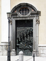 "One of the bronze doors of the St. Nicholas's Cathedral, namely the ""Ljubljana Door"" with relief portraits of some 20th-century bishops of the city, as well as the figure of Jesus Christ (work of Mirsad Begić) - Ljubljana, Slovenia"