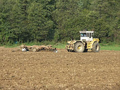 A Hungarian-made Rába-Steiger tractor plows the land at Magyaregregy village - Magyaregregy, Hungary