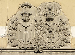 Carved limestone crests over the door of the County Library - Pécs, Hungary
