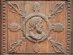 Carvings on the wooden door of the Episcopal Palace - Pécs, Hungary