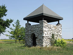 Small stone memorial- and lookout tower over the ruins of a former medieval church - Ráckeve, Hungary