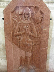 Red marble tombstone with a medieval knight figure in armor on it - Siklós, Hungary