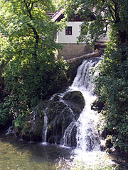 The waterfalls of the Slunjčica River flow into the Korana River, under the houses of Rastoke - Slunj, Croatia