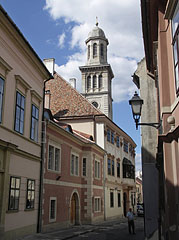 Cozy street with baroque houses and the tower of the Evangelical Lutheran Church - Sopron, Hungary