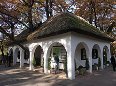 The thatched-roofed reception building at the entrance of the arboretum - Szarvas, Hungary