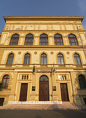 Entrance of the yellow main building, the Rector's Office of the University of Szeged (former József Attila University or Attila József University, JATE) - Szeged, Hungary