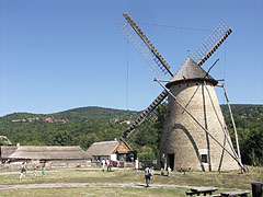 The windmill from Dusnok and the farmstead from the Nagykunság, with verdant hills in the distance - Szentendre, Hungary