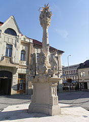 Baroque style limestone Holy Trinity Column in the main square - Tapolca, Hungary