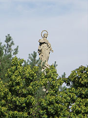 Statue of Our Lady Immaculate (Maria Immaculata) on the top of a 17-meter-tall obelisk in the main square - Tata, Hungary