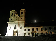The Abbey Church of Tihany by night, starts and the rising moon is in the background - Tihany, Hungary