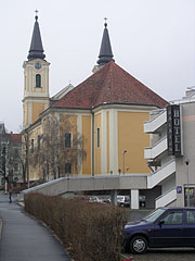 The Roman Catholic Mary Magdalene's Parish Church, and to the right in the foreground it is the Hotel Balaton - Zalaegerszeg, Hungary