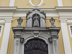 Statue of St. Francis of Assisi above the door of the Franciscan Sacred Heart of Jesus Church - Zalaegerszeg, Hungary